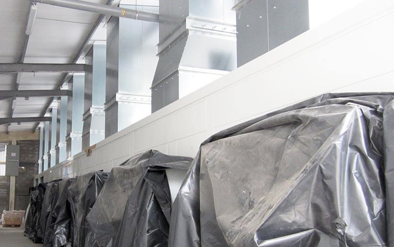 Geluidsisolerende omkasting WKK installaties